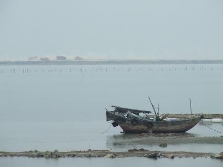 Fishing boat and trucks